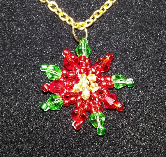 Poinsettia flower beaded Christmas necklace. Gold chain.