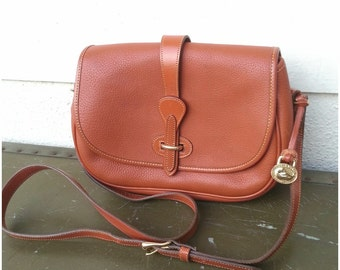 Authentic Dooney and Bourke Cognac Crossbody