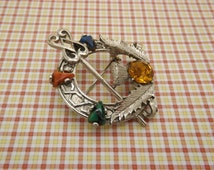 An ' Exquisite ' Celtic / Scottish Tara Annular Celtic Knot sword & shield design silvertone vintage jewelry brooch inset with mixed stones