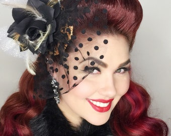 The Dita leopard fascinator
