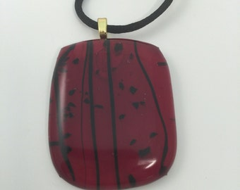 Red with black accents fused glass cabochon
