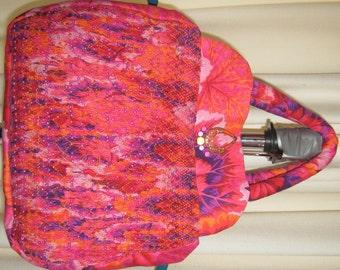 Hand smocked Bright Pink and Purple Kaffe Fassett Fabric handbag with beading detail.