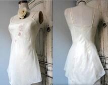 "Vintage lingerie BONWIT TELLER ivory nylon teddy /w/ cupid & floral applique, scalloped neckline, button crotch, 34"" bust, PRISTINE!"