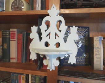 Vintage handmade wood hanging shelf in white / small scrolled knick knack wall shelf
