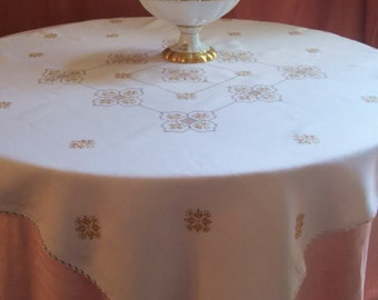 Pretty embroidered tablecloth... Vintage or old