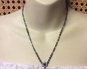 Vintage designer signed 1928 amethyst and blue glass rhinesotne necklace.