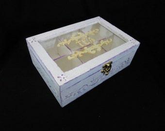 White and purple tea box