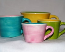 Bright pastel colors ceramic dry measuring cup set. Painted with food safe glazes and kiln fired.