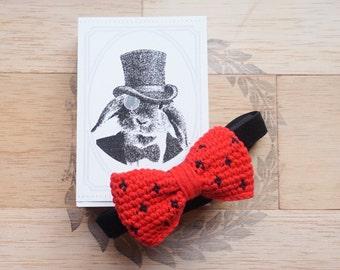 Polka dot crochet bow tie. Cardboard handmade packaging