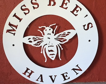 Custom metal sign with bee in white powder coat  finish
