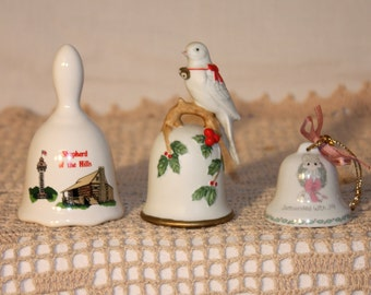 3 ceramic white bells, 1986 Lefton, 1991 Precious Moments, and Sheherd of the Hills souvenir