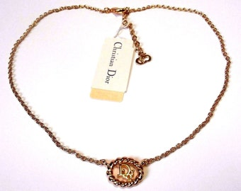 "Signed Christian Dior Symbol Necklace Gold Plated with ""Dior"" in Pendant"