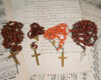 Set of 4 antique and vintage French red rosaries. Coral. Pink. Vintage glass and wood bead rosaries. Red rosaries. Lourdes rosary
