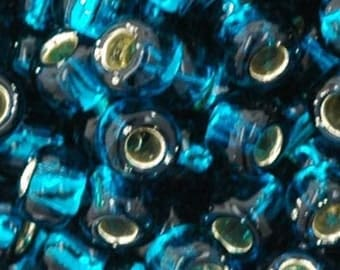 Toho 6/0 Silver Lined Teal Round 6-27BD Tube