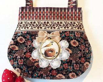 Handmade handbag using vintage velvet and braid