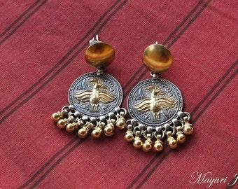 Mayur: Dual-Tone Silver earrings.