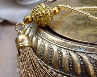 Long beaded gold tassel necklace. Gold beaded tassel necklace. Gold tassel necklace. Boho necklace. Bohemian tassel necklace.