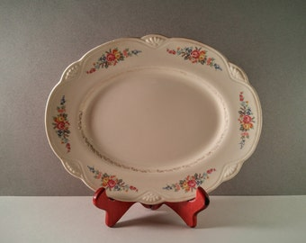 Vintage Homer Laughlin Serving Platter. Off-White with Scalloped Edge, Multi-Colored Floral Spray Design, and Gold Leaf Filigree Detail.