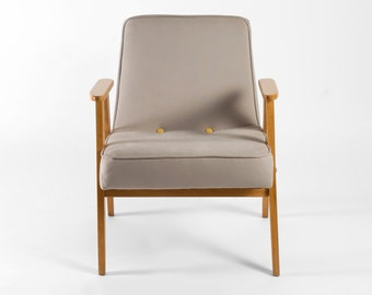 Grey mcm armchair with yellow buttons from 1961