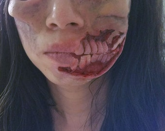 Walking dead style large exposed teeth zombie prosthetic.