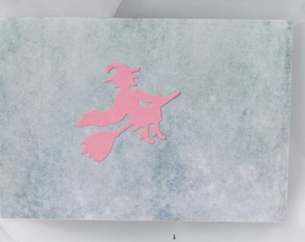 less than half price clearance sale pastel pink  flying witch on a pastel green halloween card
