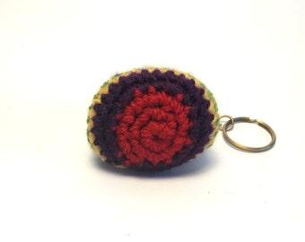crochet purse/keychain with ballclasp in multicoloured yarn.