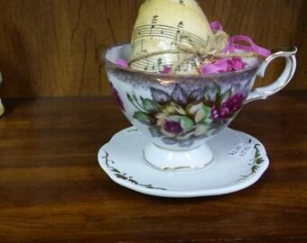 Decoupage egg in tea cup