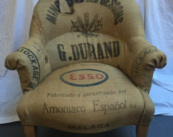 Overstuffed Esso chair with patches