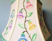 Lampshade: Medium hex-bell shade from vintage tablecloth. Sweet, loopy embroidered blooms in blue,pink,yellow,lilac. Classic cottage chic!