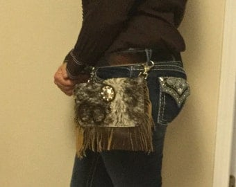 Hair on cowhide fanny pack/purse.