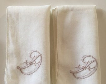 Two vintage napkins with the letter D monogrammed in a taupe color