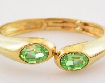 Vintage Lovely bangle bracelet with wonderful green stones.