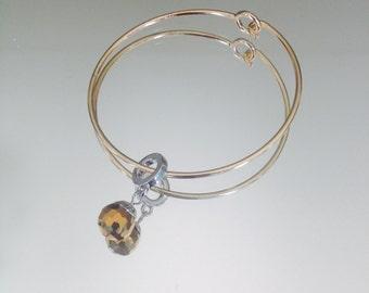 Nickel free, gold tone bangle bracelet with gold/auburn disco ball charm