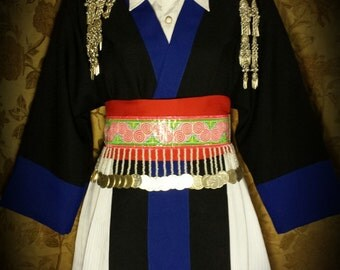A beautiful original Hmong outfit in blue and black with red slash.