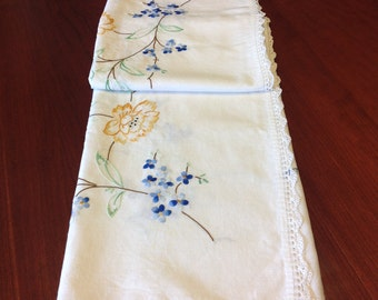 Embroidered flowered tablecloth