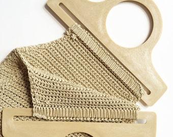 Bohemian crochet bag with large plastic handle.