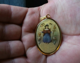 Santo Nino de Atocha and Divine Child two sided pendant