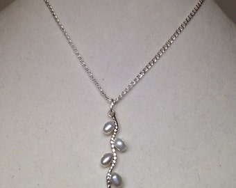 """Cultured silver pearl and sterling silver pendant hangs delicately on 15"""" sterling silver chain. Lovely!"""