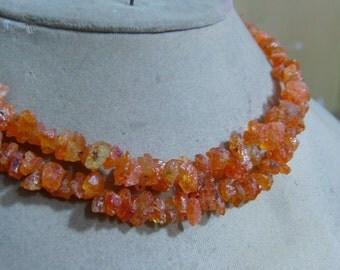 1 Strand Spessartite Garnet rough beads  11''  32, grams 5X6. 7X10. MM
