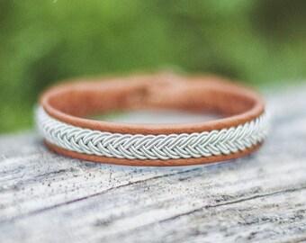 Sami bracelet made of reindeer leather, braided pewter wire/tin thread and reindeer antler – fisbone braid – custom made