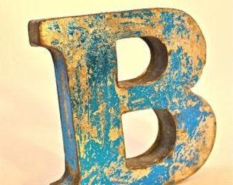 A fantastic vintage style metal 3D blue letter B