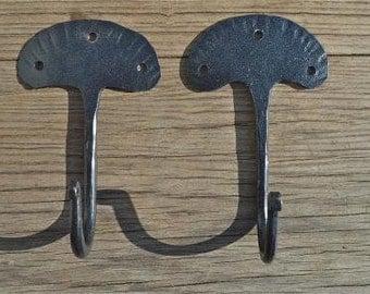 A pair of hand wrought iron primitive folk art hooks QHH1