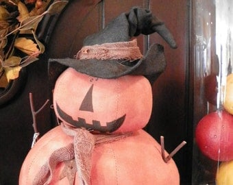 pumpkin figure with witch hat