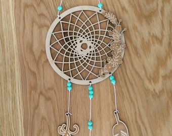 Dream catcher. Wooden dream catcher with feathers and beads.