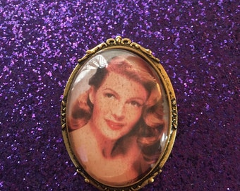 Rita Hayworth brooch with gold cameo