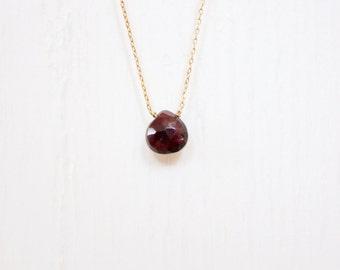 Handmade delicate gemstone necklace. Garnet teardrop on a 14kt gold filled chain.