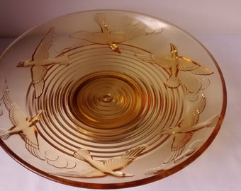 ART DECO 1930  pressed glass yellow fruit, glass raised bowl decorated in Relief with birds and cloudds. signed Am
