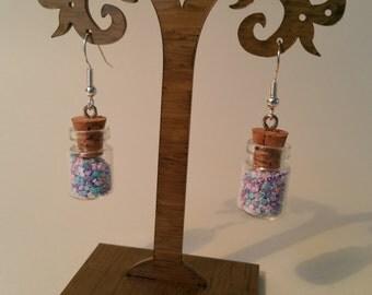 Lovely glass bottle drop earrings with Sterling silver hooks.