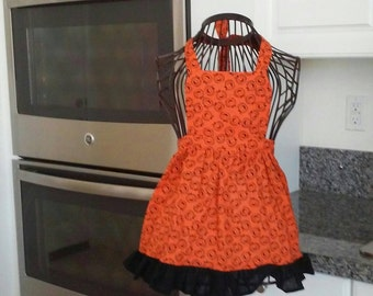 Cute pumpkin apron for your little girl.