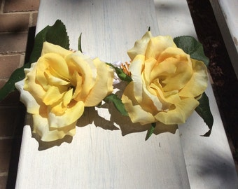 Matching pair of yellow Hair flowers on combs
